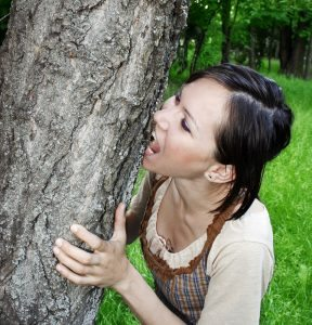 A woman biting a tree out of sheer unbridled hatred.